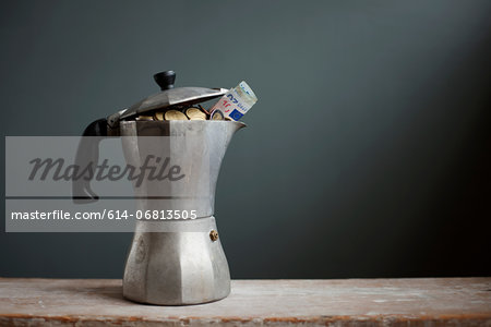 Coffee pot with Euros inside Stock Photo - Premium Royalty-Free, Image code: 614-06813505
