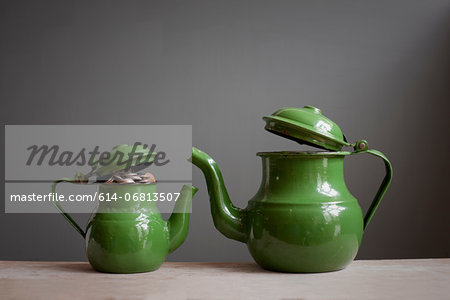 Two teapots with money inside Stock Photo - Premium Royalty-Free, Image code: 614-06813507