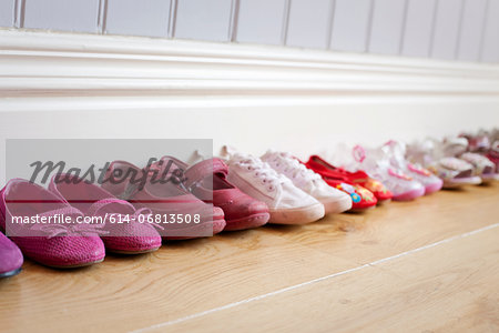 Child's shoes in a row Stock Photo - Premium Royalty-Free, Image code: 614-06813508