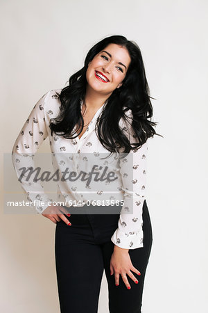 Young woman wearing patterned blouse Stock Photo - Premium Royalty-Free, Image code: 614-06813585