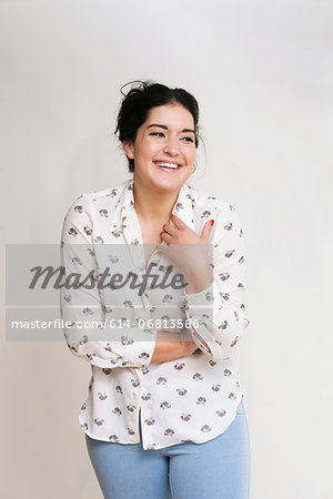 Young woman wearing patterned blouse Stock Photo - Premium Royalty-Free, Image code: 614-06813586