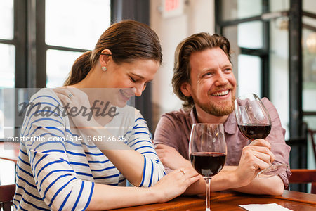 Couple at wine bar Stock Photo - Premium Royalty-Free, Image code: 614-06813635