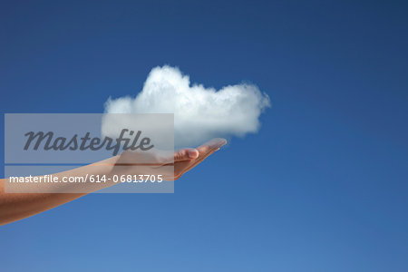Hand holding cloud against blue sky Stock Photo - Premium Royalty-Free, Image code: 614-06813705