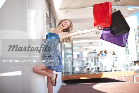 One happy young women swinging shopping bags Stock Photo - Premium Royalty-Free, Image code: 614-06813771