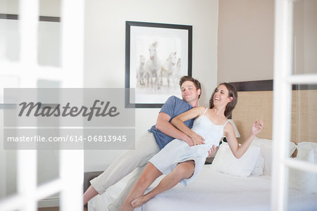 Young couple falling on bed Stock Photo - Premium Royalty-Free, Image code: 614-06813945