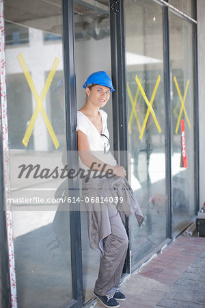 Portrait of female construction worker on construction site Stock Photo - Premium Royalty-Free, Image code: 614-06814039