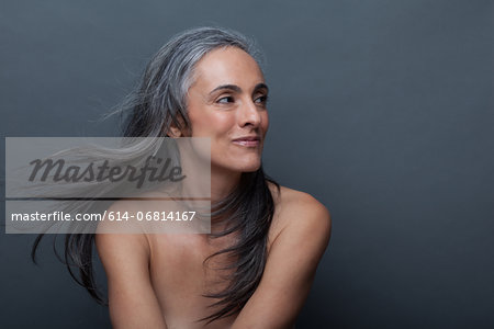 Mature woman with windswept hair Stock Photo - Premium Royalty-Free, Image code: 614-06814167