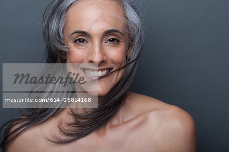 Mature woman with windswept hair Stock Photo - Premium Royalty-Free, Image code: 614-06814168