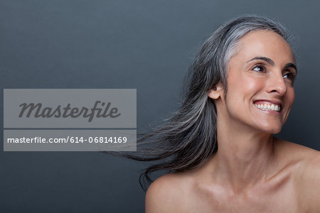 Mature woman with windswept hair Stock Photo - Premium Royalty-Free, Image code: 614-06814169