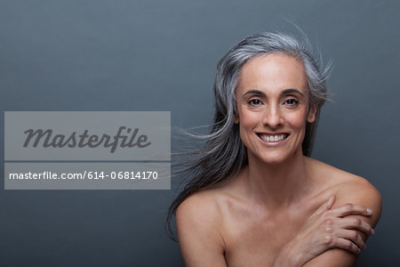 Mature woman touching arm Stock Photo - Premium Royalty-Free, Image code: 614-06814170
