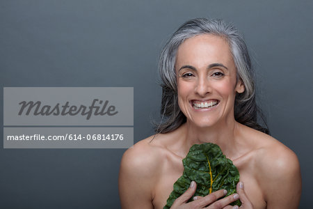 Mature woman with chard Stock Photo - Premium Royalty-Free, Image code: 614-06814176