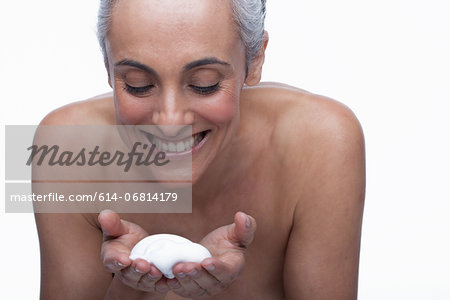 Mature woman cleansing face Stock Photo - Premium Royalty-Free, Image code: 614-06814179