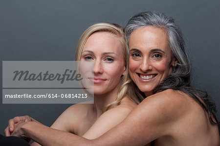Young woman and mature woman hugging Stock Photo - Premium Royalty-Free, Image code: 614-06814213