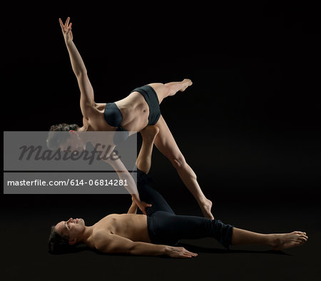 Mid adult couple performing modern dance Stock Photo - Premium Royalty-Free, Image code: 614-06814281