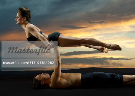 Mid adult couple performing modern dance Stock Photo - Premium Royalty-Free, Image code: 614-06814282