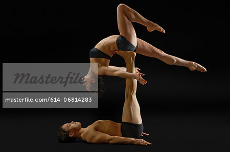Mid adult couple performing modern dance Stock Photo - Premium Royalty-Free, Image code: 614-06814283