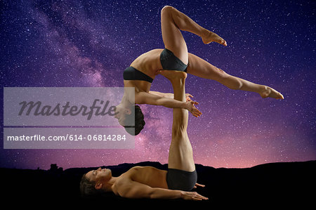 Mid adult couple performing modern dance Stock Photo - Premium Royalty-Free, Image code: 614-06814284