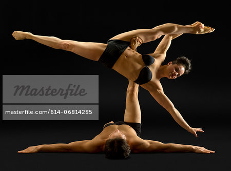 Mid adult couple performing modern dance Stock Photo - Premium Royalty-Free, Image code: 614-06814285