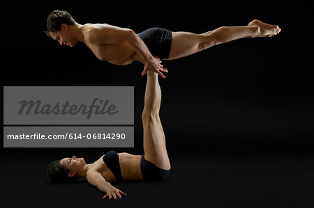 Mid adult couple performing modern dance Stock Photo - Premium Royalty-Free, Image code: 614-06814290