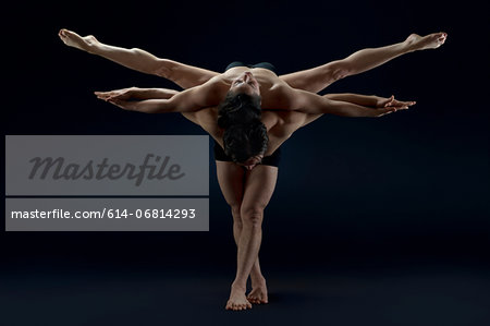 Mid adult couple performing modern dance Stock Photo - Premium Royalty-Free, Image code: 614-06814293
