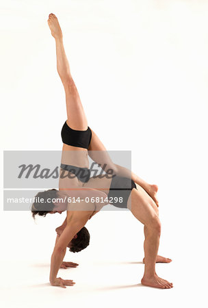 Mid adult couple performing modern dance Stock Photo - Premium Royalty-Free, Image code: 614-06814298