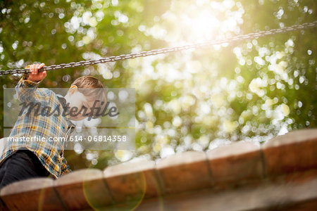 Male toddler crossing wooden footbridge Stock Photo - Premium Royalty-Free, Image code: 614-06814358