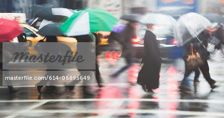 Line of people crossing city street in rain Stock Photo - Premium Royalty-Free, Image code: 614-06895649