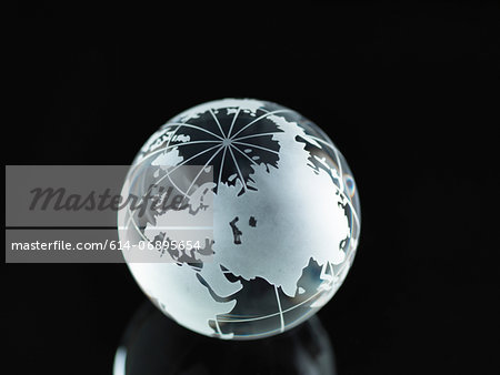 Glass Globe illustrating Asia, India, China, Russia, Africa, Saudi Arabia, Middle East Stock Photo - Premium Royalty-Free, Image code: 614-06895654