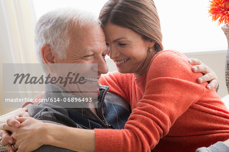 Mature woman and senior man hugging Stock Photo - Premium Royalty-Free, Image code: 614-06896493