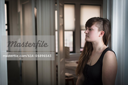 Young woman in doorway Stock Photo - Premium Royalty-Free, Image code: 614-06896543