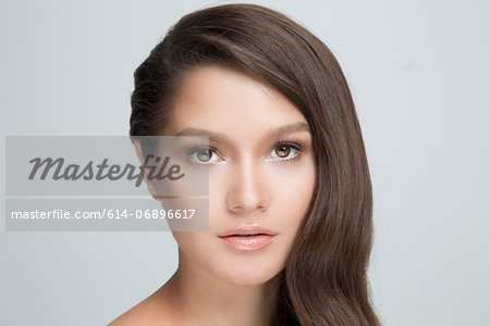 Portrait of woman with brown hair Stock Photo - Premium Royalty-Free, Image code: 614-06896617
