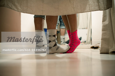 Young couple wearing socks in changing room, low section Stock Photo - Premium Royalty-Free, Image code: 614-06896782