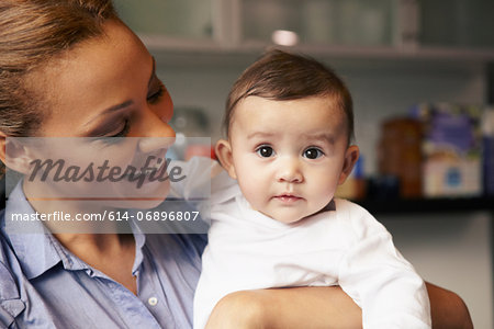Mother holding baby girl Stock Photo - Premium Royalty-Free, Image code: 614-06896807