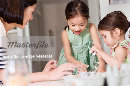 Mother and young daughters making pastry Stock Photo - Premium Royalty-Free, Image code: 614-06896964