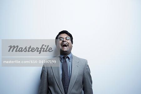 Studio portrait of mid adult male laughing Stock Photo - Premium Royalty-Free, Image code: 614-06897199