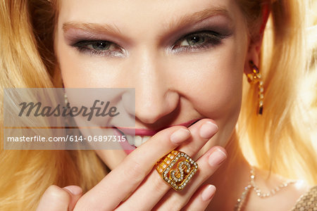 Close up portrait of young woman wearing diamond signet ring Stock Photo - Premium Royalty-Free, Image code: 614-06897315