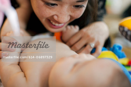 Close up of mother and baby daughter Stock Photo - Premium Royalty-Free, Image code: 614-06897329