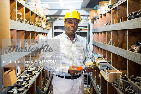 Portrait of man in plumbing stockroom with products Stock Photo - Premium Royalty-Free, Image code: 614-06897342