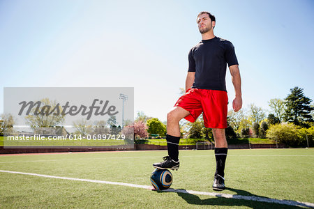 Soccer player preparing for free kick Stock Photo - Premium Royalty-Free, Image code: 614-06897429