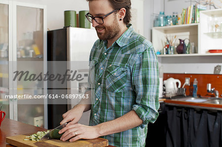 Man chopping vegetables Stock Photo - Premium Royalty-Free, Image code: 614-06897563