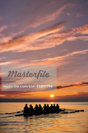 Eight people rowing at sunset Stock Photo - Premium Royalty-Free, Image code: 614-06897796