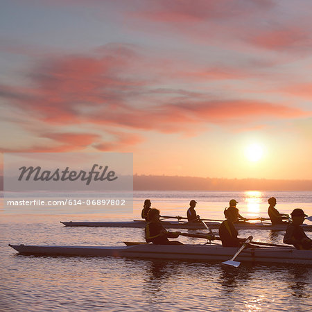Seven people rowing at sunset Stock Photo - Premium Royalty-Free, Image code: 614-06897802