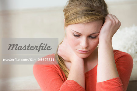Sad teenage girl with hand on head Stock Photo - Premium Royalty-Free, Image code: 614-06897811