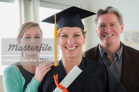 Mother wearing mortarboard with daughter and husband Stock Photo - Premium Royalty-Free, Image code: 614-06897831
