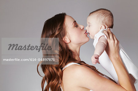 Mother kissing baby daughter Stock Photo - Premium Royalty-Free, Image code: 614-06897875