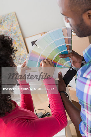 Mid adult couple with colour swatches Stock Photo - Premium Royalty-Free, Image code: 614-06897973
