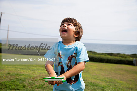 Boy flying kite Stock Photo - Premium Royalty-Free, Image code: 614-06898007