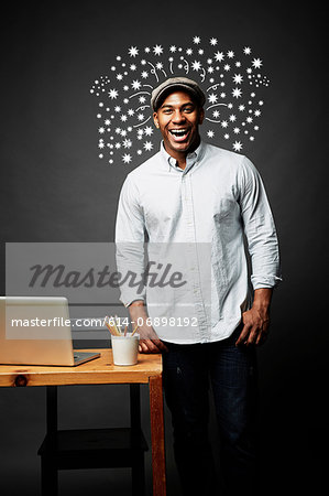 Laughing man bursting with great ideas Stock Photo - Premium Royalty-Free, Image code: 614-06898192