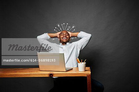 Man laughing with explosion of ideas Stock Photo - Premium Royalty-Free, Image code: 614-06898193