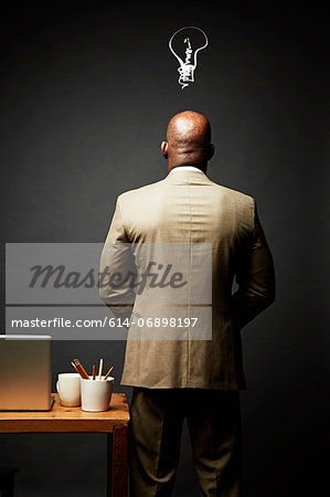 Back view of man thinking of idea Stock Photo - Premium Royalty-Free, Image code: 614-06898197